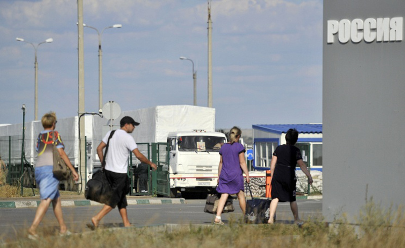 Putin approves simplified procedure of issuing residence permits to refugees from Ukraine