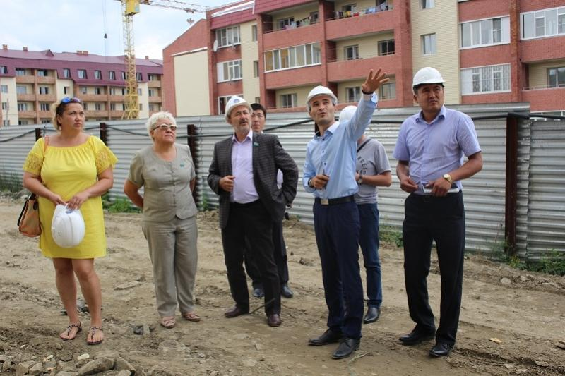 Kazakh MP visits residential complexes under construction in E Kazakhstan